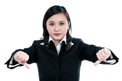 Agitated businesswoman showing thumbs down sign Stock Photos