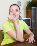Agitated girl biting fingers. Agitated girl deep in thought biting fingers at home Stock Photos