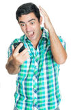 Agitated man yelling at his mobile phone. And gesturing with his hands (isolated on white Royalty Free Stock Images