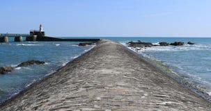 Agitated sea on la Chaume breakwater stock video