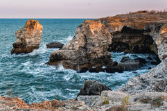 Agitated sea at Tyulenovo, Bulgaria. A beautiful view of a rocky shore. This  is in Bulgaria at Tyulenovo, a spectacular arch made of stone Stock Images