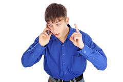 Agitated teenager with phone. Isolated on the white background Royalty Free Stock Image
