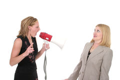 Agitated Two Business Women Team 3. Extreme two person business team with one worker shouting commands through a megaphone Royalty Free Stock Photos