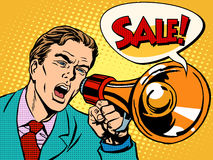 Agitator with megaphone announces sale Stock Photos