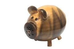 Agitatore di sale a forma di del maiale su priorità bassa bianca Fotografie Stock