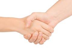 Agitazione delle mani di due genti, dell'uomo e della donna. Immagine Stock