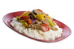 Agite a carne de porco e vegetais fritados Foto de Stock