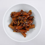 Agite a carne de porco fritada com molho de soja doce preto Fotos de Stock
