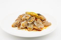 Agite moluscos fritados com pasta roasted do pimentão, alimento tailandês Fotografia de Stock Royalty Free