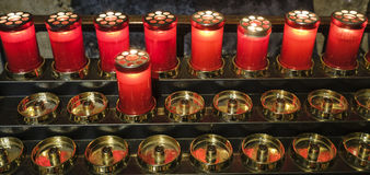 Agliate Brianza Italy: historic church, candles Royalty Free Stock Photography
