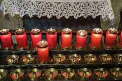 Agliate Brianza Italy: historic church, candles Stock Photography
