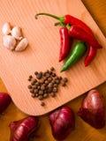 Aglio, cipolle e peperoni Fotografia Stock Libera da Diritti