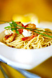 Aglio e Olio with Seafood. Spaghetti pan-fried with garlic and olive oil; the most simple of Italian pasta dressing and well-loved all over the world. This dish Royalty Free Stock Images