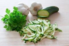 Aglio e prezzemolo del briciolo dello zucchini Fotografia Stock Libera da Diritti