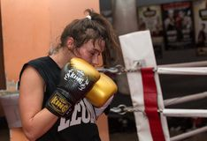 Agnieszka Niestoj - talented Polish boxer durning boxing training with coach in the gym. Cracow, Royalty Free Stock Image