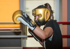 Agnieszka Niestoj - talented Polish boxer durning boxing training with coach in the gym. Cracow, Royalty Free Stock Photography
