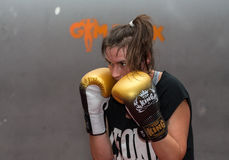 Agnieszka Niestoj - talented Polish boxer durning boxing training with coach in the gym. Cracow, Poland Royalty Free Stock Photos