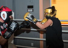 Agnieszka Niestoj - talented Polish boxer durning boxing training with coach in the gym. Cracow, Poland Stock Image