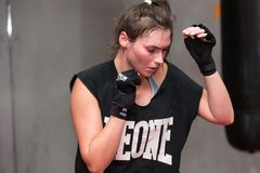 Agnieszka Niestoj - talented Polish boxer durning boxing training with coach in the gym. Cracow, Royalty Free Stock Photos