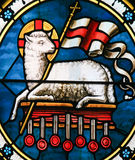 Agnus Dei - Lamb of God - Stained Glass. Agnus Dei. Stained Glass of a lamb holding a Christian banner, symbol for Lamb of God Stock Images