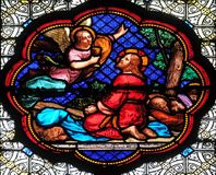 Agony in the Garden, Jesus in the Garden of Olives. Stained glass window in the Basilica of Saint Clotilde in Paris, France royalty free stock images