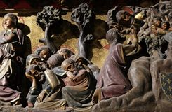 Agony in the Garden, Jesus in the Garden of Gethsemane. Intricately carved and painted frieze inside Notre Dame Cathedral depicting Agony in the Garden, Jesus in stock images