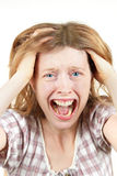 Agony. Young woman screaming in agony with mouth wide open holding head stock images