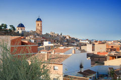 AGOST, SPAIN - JULY 4, 2015: Panoramic view of the town on the t Stock Photos
