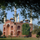 Agra. The Entrance building to the area of the Sikandra tomb of Mughul Emperor Akbar. Side view through the trees on the Entrance building to the area of the Royalty Free Stock Photography