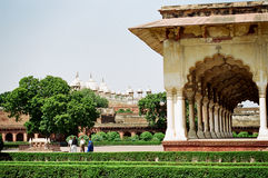 Agra Fort, India. A decorated corridor and temples in the background in the Agra Fort of India royalty free stock photos