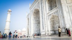 Taj Mahal front entrance view in Agra, India with tourists in front stock photo