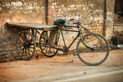 AGRA, INDIA - CIRCA NOV 2012: An improvised tricycle with a wood Stock Image