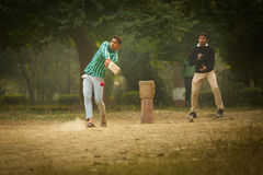 AGRA, INDIA - JAN 09: Young boys playing cricket in a parc of Ag Royalty Free Stock Photos