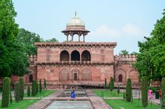 Taj Mahal in Agra, India. Agra, India - Jul 13, 2015. People walking at Taj Mahal in Agra, India. The palace was commissioned in 1632 by Shah Jahan, to house the Royalty Free Stock Photos