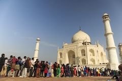 AGRA, INDIA - MARCH, 25 2012 - A Group of unidentified Indian people staying in the queue in front of Taj Mahal tomb Royalty Free Stock Image