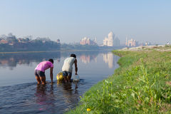Water carriers in Yamuna river opposite the Taj Mahal Stock Images