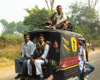 The people of India go by transport stock photos