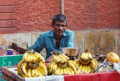Indian man sells bananas royalty free stock photography