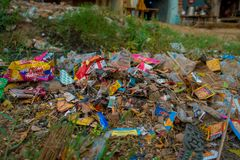 AGRA, INDIA - SEPTEMBER 19, 2017: Big garbage heap on the street on Agra, India. India is a very dirty country Royalty Free Stock Images