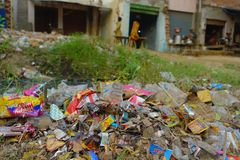 AGRA, INDIA - SEPTEMBER 19, 2017: Big garbage heap on the street on Agra, India. India is a very dirty country Stock Image
