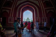 Agra, India - September 20, 2017: Crowd of people walking through a huge door with the Taj Mahal in the horizont , is an Stock Photos