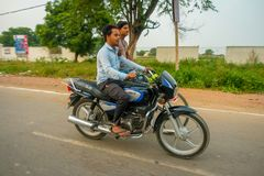 AGRA, INDIA - SEPTEMBER 19, 2017: Unidentified men rides a motorcycle and his friend a byke in the streets in central Royalty Free Stock Images