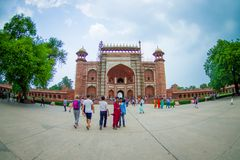 Agra, India - September 20, 2017: Unidentified people at the Great gate, Darwaza-i rauza, main entrance to the tomb Stock Photo