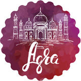 Agra label with hand drawn the Taj Mahal, lettering Agra. On watercolor purple background Royalty Free Stock Images