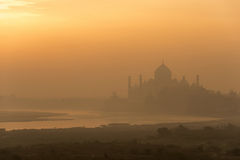 Agra sunrise. Golden sunrise over Taj Mahal and Yamuna river in Agra, India Royalty Free Stock Photo