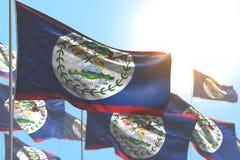 Agradável muitas bandeiras de Belize estão acenando contra a imagem do céu azul com foco macio - toda a ilustração da bandeira 3d ilustração royalty free