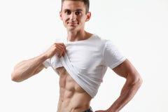 Agradecimentos da imprensa do ` s dos homens fortes à dieta e ao treinamento constante Imagem de Stock