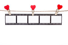 Agrafe de forme de coeur sur une ficelle, négatifs accrochants, film d'amour Image libre de droits