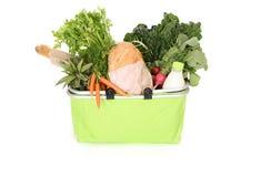 Agrafes de nourriture dans le sac à provisions Photo stock