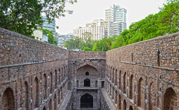 Agrasen's Baoli and modern buildings. Historical/ancient  monument Agrasen/Ugarsen's Baoli (step well) located in connaught place new delhi, India with modern Royalty Free Stock Photography
